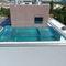 piscina seminterrata / in vetro / in acciaio inossidabile / per hotel