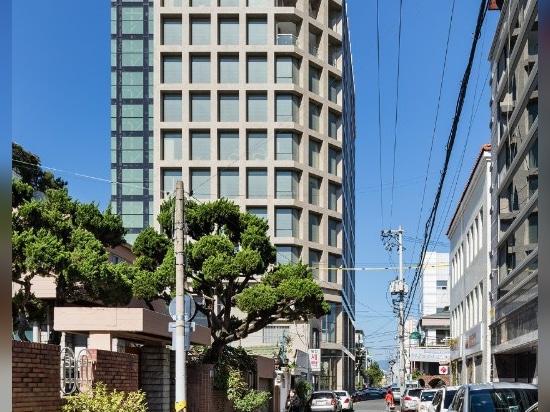 La Corea del Sud. Le facciate rigorose di un punto di riferimento urbano monolitico