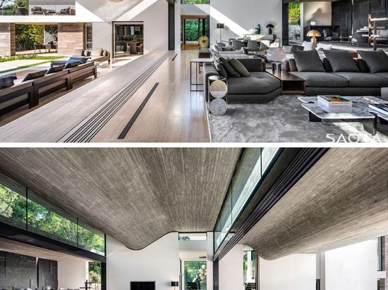 Questa nuova casa in Francia ha un soffitto ondulato in cemento armato