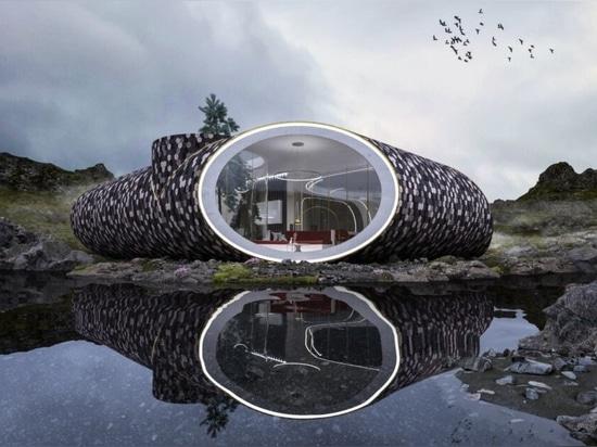 La casa futuristica, ispirata alle conchiglie, è rivestita di legno recuperato